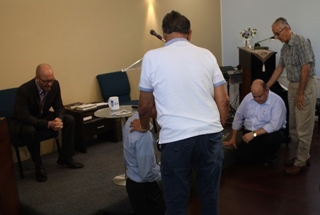 The men of the church praying for us.